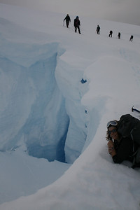 Laying down on an ice bridge in the Antarctic peninsula