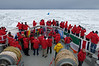 Guests on the bow of the NG Explorer having just crossed the Antarctic Circle edit