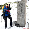 Tradition holds that visitors to Shackleton's gravesite share some scotch with him in spirit.   I am pouring scotch on the grave but in actuality it is falling on my boot!   And the scotch seems to be frozen by the time it reaches the boot!