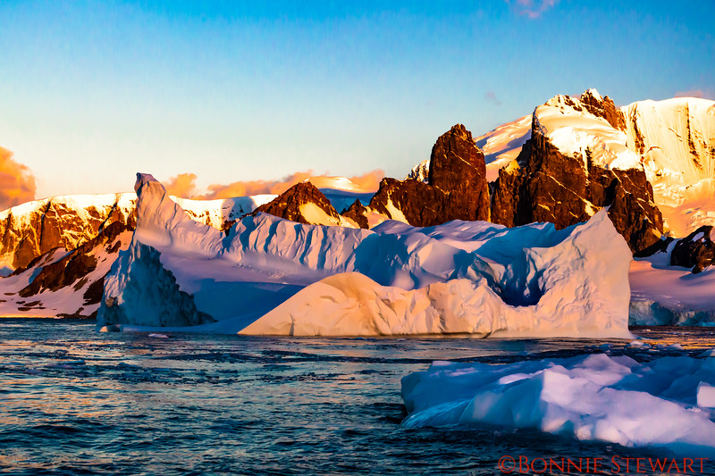 Sunset in Antarctica with a view of a massive iceberg