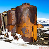 Remnants of an old abandoned Norwegian whaling town at Deception Island in the South Shetland Islands archipelago.   The town was built in the early 1890's and abandoned in 1959.  These are the whaling storage containers with seals sunbathing next to the storage vessels.