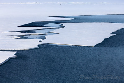 Break up of the sea ice on the McMurdo Ice Shelf, a portion of the Ross Ice Shelf demarcated by Ross Island, Black Island, and Minna Bluff