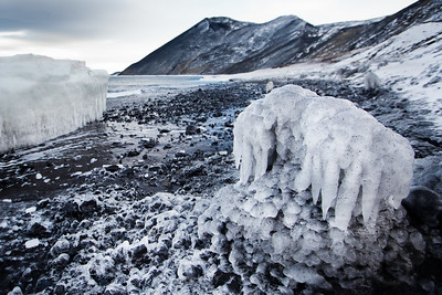 Icicles and ice floes ashore formed by freezing tidal waters
