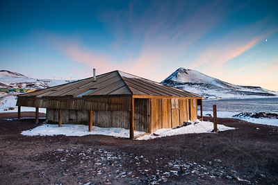 Scott's Discovery Hut, McMurdo, and Observation Hill separated by Winter Quarters Bay