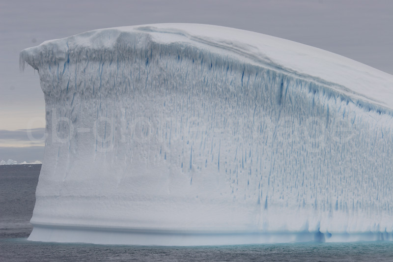 Icebergs are caused when large chunks break off a glacier. Only one-ninth of its volume is reflected on the water surface, while most of swimming underwater.