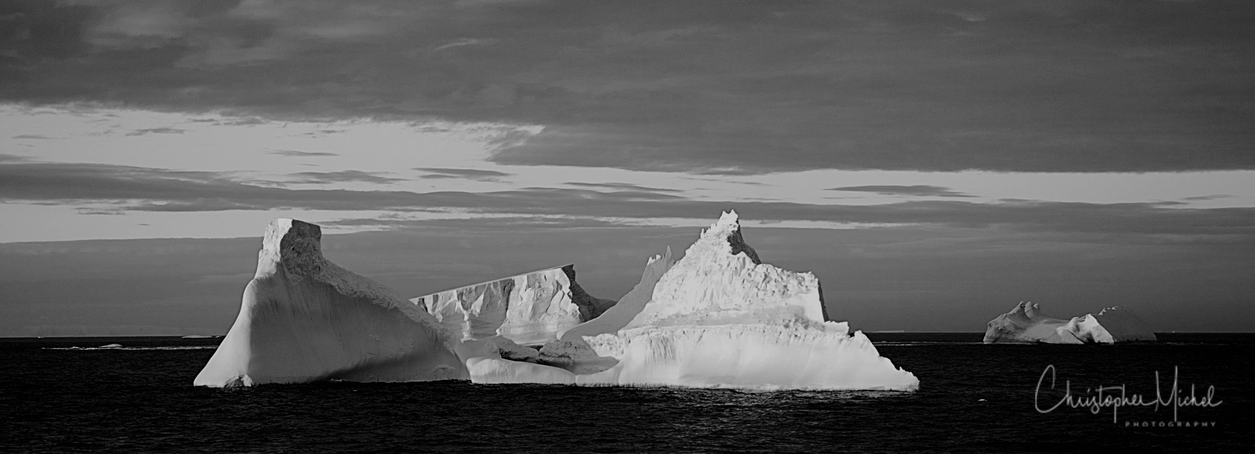 The ice was here, the ice was there, The first view of Antarctica is always an iceberg. It may be a monolith hovering on the horizon, a barely discernible spectre looming out of the mist, or perhaps a sun-spangled, dazzling icon marking the gateway to this new world. It will undoubtably be icebergs that leave the most lasting impressions on the imagination of visitors.  —Mark Jones, Wild Ice