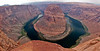 Horseshoe Bend, near Page, Arizona. My 24mm lens wasn't nearly wide enough to get this all in. This is actually a 10-shot panorama from as close to the edge as I could force myself to get. In the upper right, to the right of the island, the little blue dot is a raft with perhaps 10 people in it. <br /> <br /> Photo by Dennis