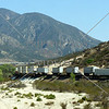 Train moves containers through the valley near San Bernardino, California.