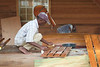 Craftsman preparing to varnish floorboards