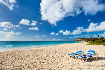 Idyllic tropical Darkwood beach at Antigua island in Caribbean with white sand, turquoise ocean wate