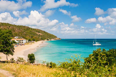 Idyllic tropical Turners beach with white sand, turquoise ocean water and blue sky at Antigua island