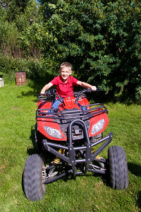 Ben tearing up Uncle Bob's property!  Those things sure go fast.