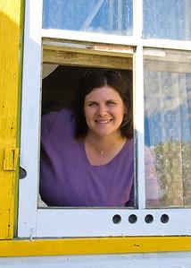 Darcie looking through great-grandma Antoshkiw's window