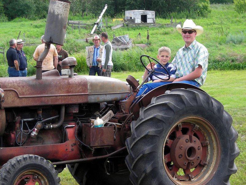 Ben and Darcie's cousin Ryan tilling the land