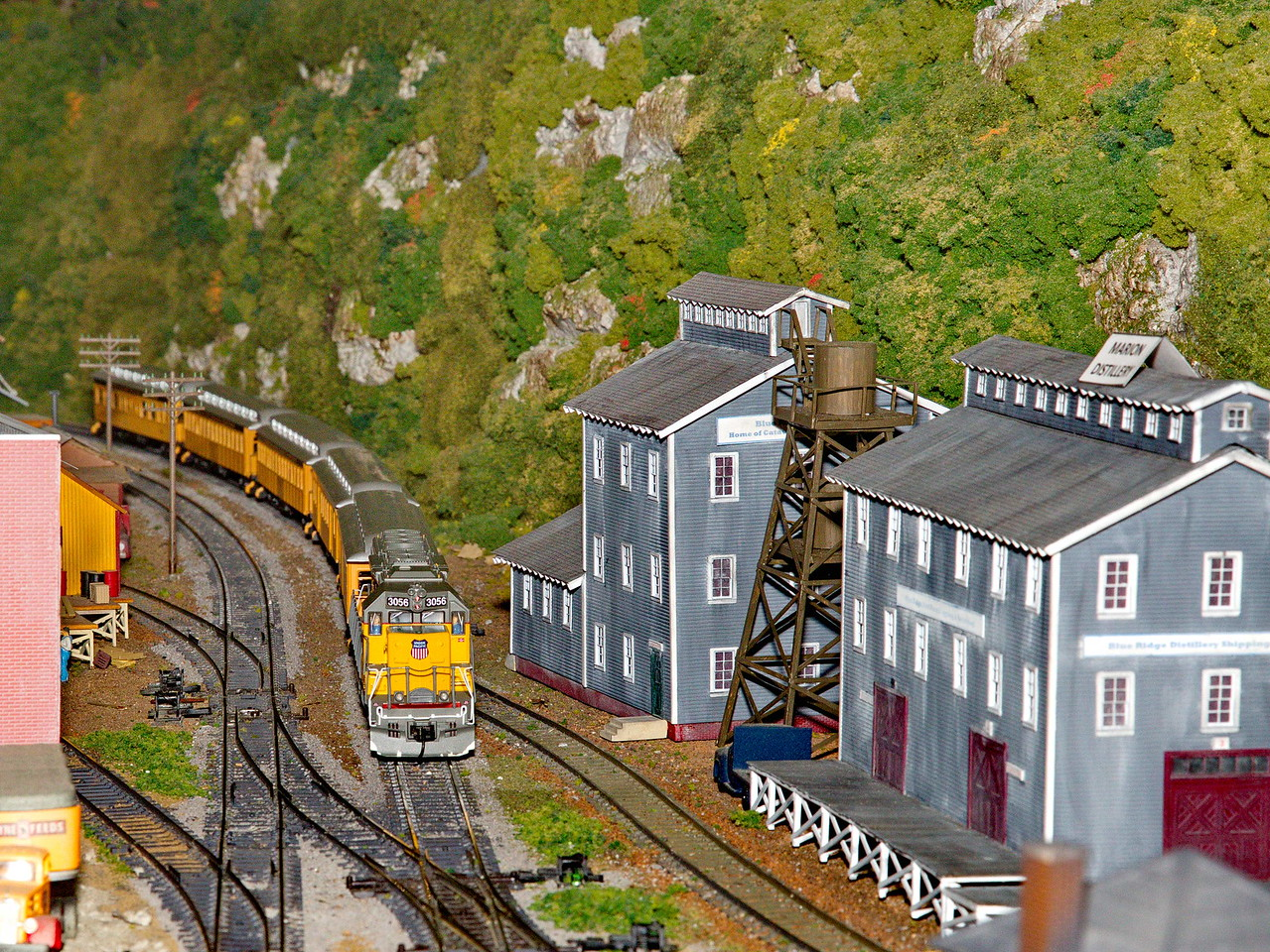 The Union Pacific passenger train passes a distillery.