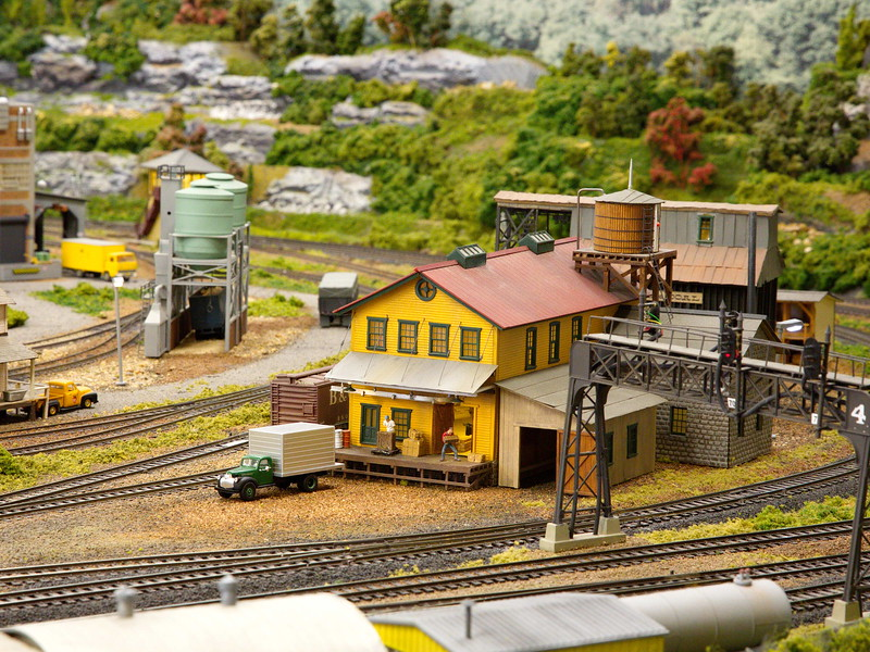 An industrial part of town with railroad tracks running virtually everywhere.