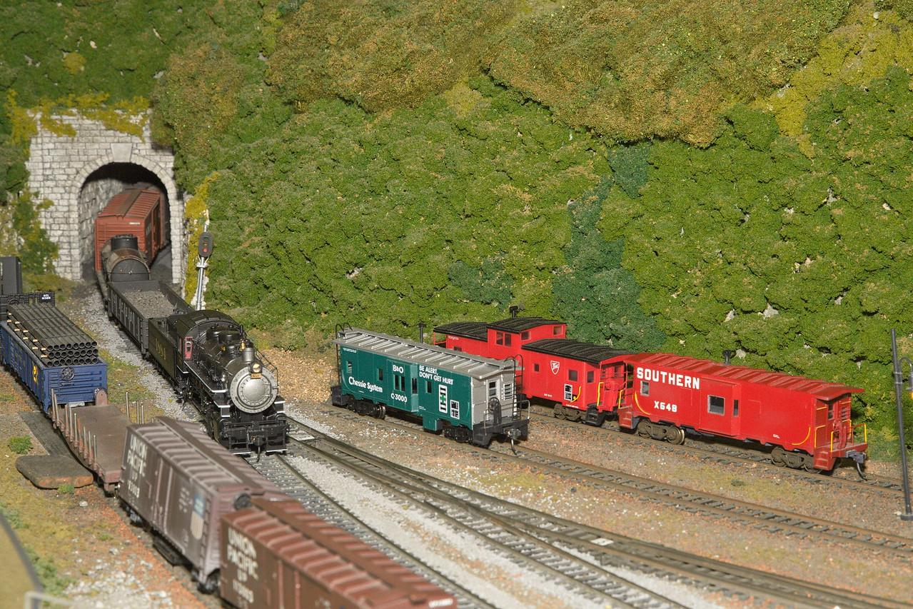 Southern Railway steam engine 1884 pulls a freight train through a tunnel.
