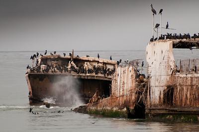 Splash the water swirls around the deteriorating ship before crashing against it.