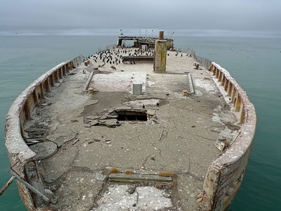 Cement ship at the end of the wooden pier.