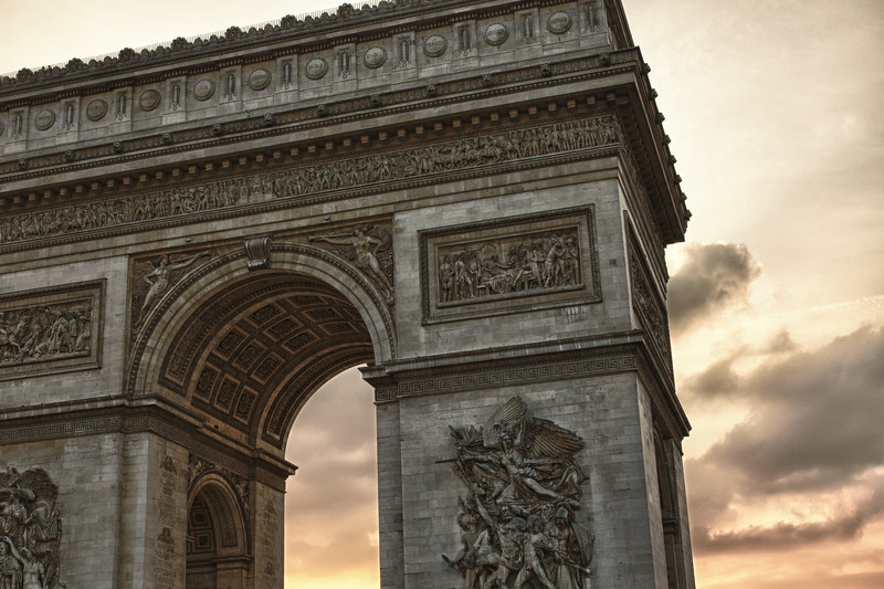 Sunset behind Arc de Triomphe.