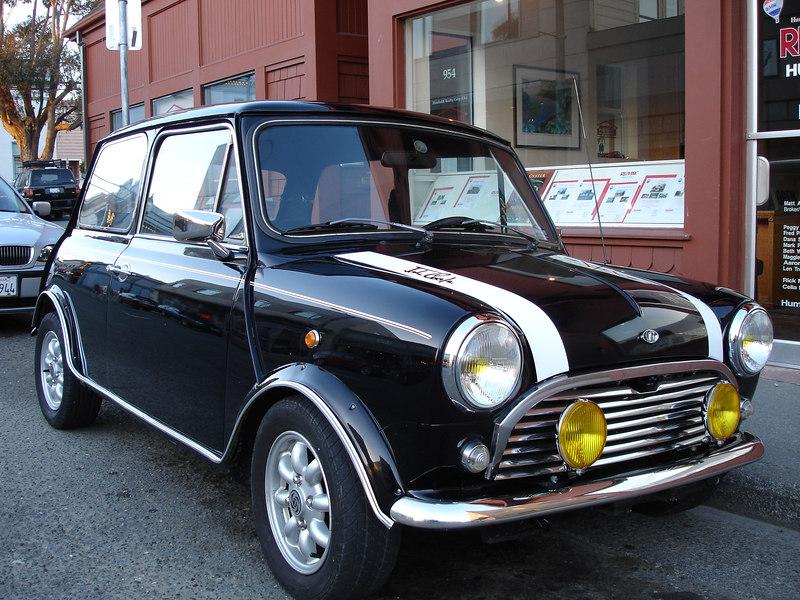 A classic Mini Cooper. John Cooper's name is on the racing stripe.