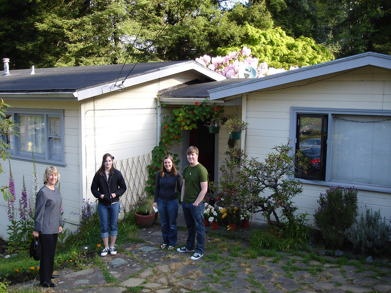 From left to right: Pam, Chelsea, Caitlin and Winslow, standing at the front entrance of Winslow and Caitlin's home.