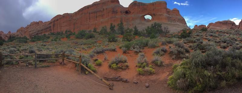 Tiny arch, big cliff