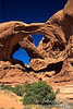 People Hiking at the base of Double Arch, Arches National Park, Moab, Utah, USA, North America