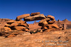 Delicate Arch seen through Rock Cairns, Delicate Arch Viewpoint Trail, Arches National Park, Moab, Utah, USA, North America