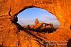 Sunrise, Turret Arch seen Through North Window, Arches National Park, Moab, Utah, USA, North America