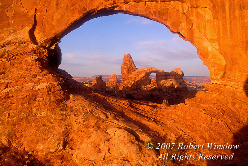 Sunrise, Turrent Arch seen through North Window, Arches National Park, Utah, USA, North America