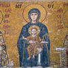 Apse mosaics - Mary is sitting on a throne without a back, holding the Child Jesus on her lap surrounded by archangels Gabriel and Michael.