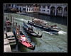 Delivery boat passing gondolas on Grand Canal