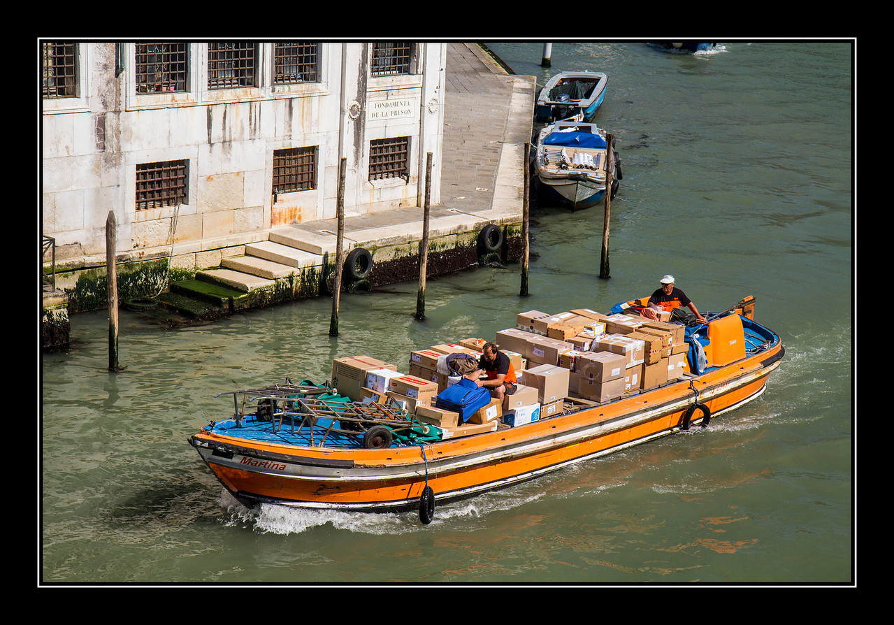 IMAGE: https://photos.smugmug.com/Travel/Architecture/Venice/i-qHWHStd/0/541dc583/X2/Grand%20Canal%20delivery%20boat-X2.jpg