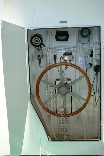 The locker contained a wheel, compass, rudder angle indicator, and sound-powered telephone to the bridge. When all else fails...