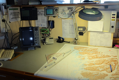 The Navigation Room, inboard portion, aft of the bridge. Our position was constantly plotted on paper charts, a best practice.