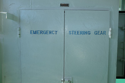 Inside this locker, on the main deck, aft, was the emergency steering gear.