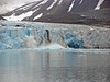 """Glaciers calving """"bergie bits"""" into the water."""