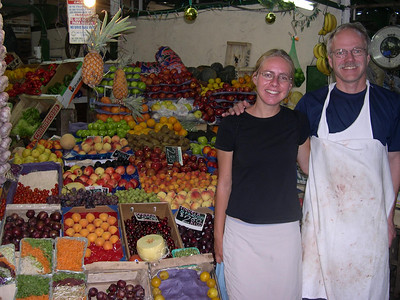 Fruit market: We bought fruit here that was as delicious as it was beautifully arranged.  A nearby vendor thought Sheldon should wear his apron for the photo!
