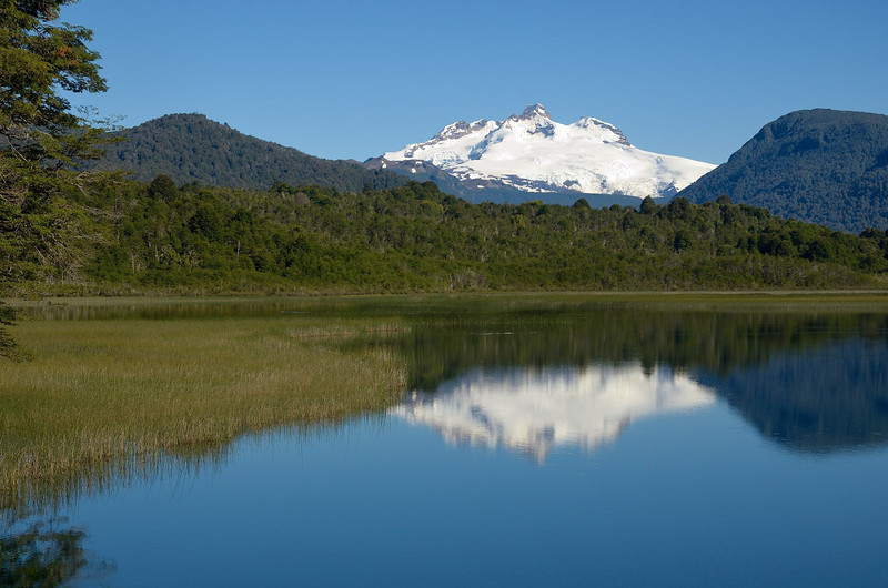 Cerro Tronador reflected in Hess Lake as seen from Rio Manso Lodge.<br /> Saturday January 12, 2013