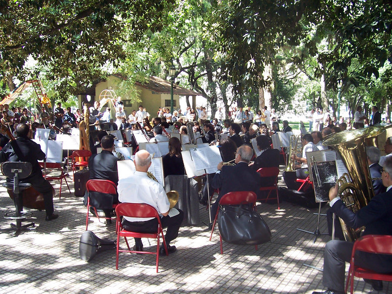 <h3>A full orchestra giving an early afternoon concert in Plaza San Martin, Buenos Aires.</h3>
