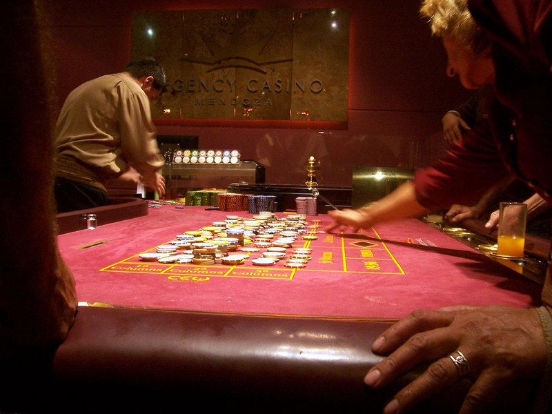<h3>Lots of bets on this roulette table at the Mendoza casino.  (A non-flash surreptitious photo.)</h3>