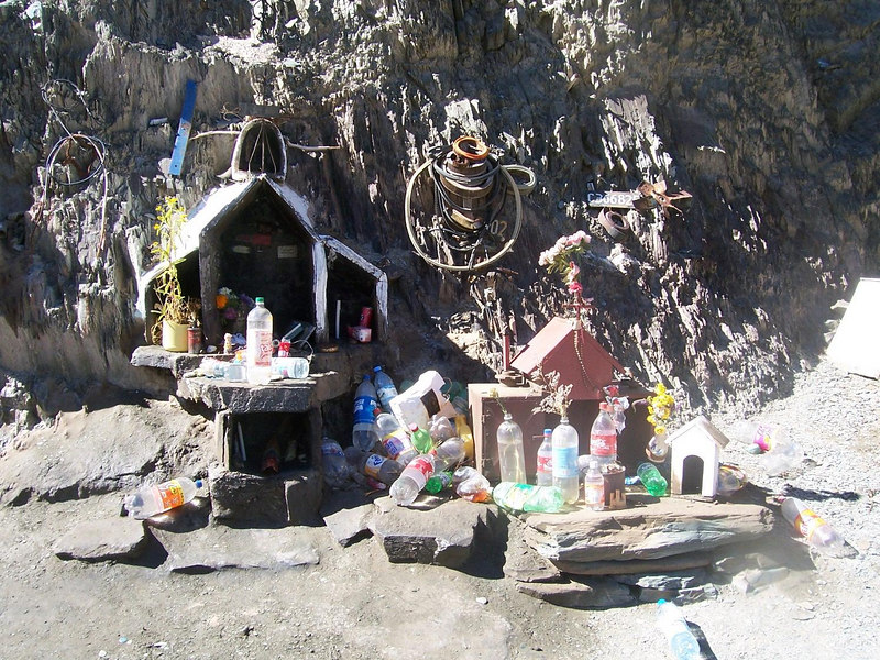 <h3>A typical roadside shrine.  The placement of empty plastic bottles is not a sign of disrespect.  Many contain liquids, and are a form of offering.</h3>