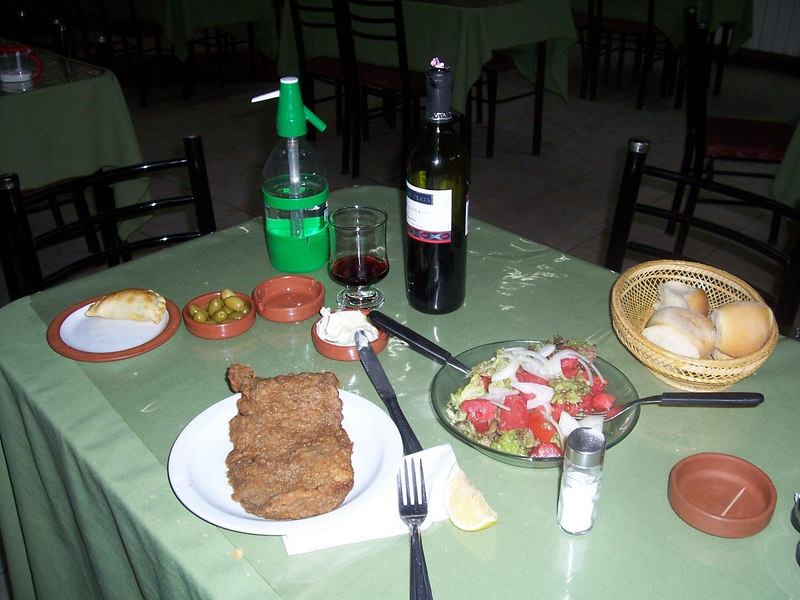 <h3>My first Jachal meal:  empanada, olives, bread, salad, wine, soda water, their special bread spread (tip of knife is in it), and melanesa (thin slice of beef, lightly breaded and fried).</h3>