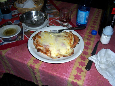 Milanesa a la Neopolitana:  A thin slice of beef, coated with a thin batter, fried, with a layer of ham and cheese on top.