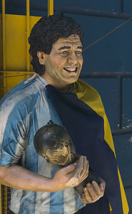 A statue of Diego Maradona in the Argentina soccer uniform outside of the Boca Junior Football stadium