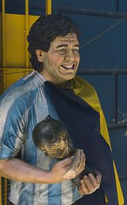 A statue of Diego Maradona in the Argentina soccer uniform outside of the Boca Junior Football stadium
