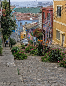 Valparaiso has many steep hills.  The harbor and part of the modern city can be seen in the distance.