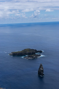 View from Orongo out to sea. Motu Nui (an essential location in the Bird Man cult), with the smaller Motu Iti in front and the isolated sea stack of Motu Kau Kau in the foreground.