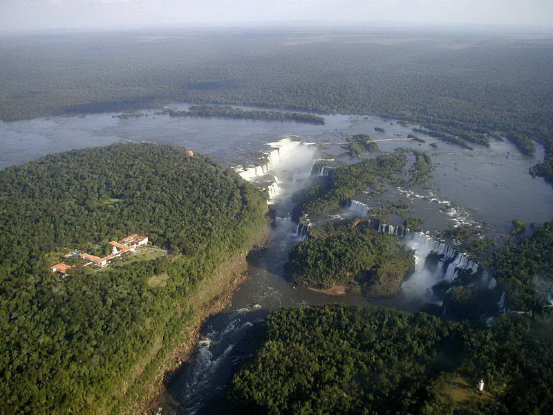 Aerial view of the waterfalls of Iguazu. The Devil's Throat (centre) drops 82 metres and is 150 metres wide. Brazil is on the left, Argentina is on the right.